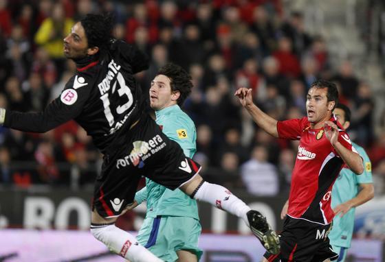 El Barcelona gana en Mallorca con goles de Messi, Villa y Pedro (0-3). /Reuters