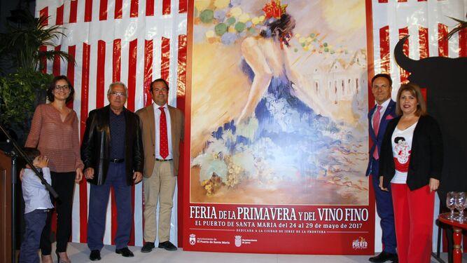 Una reproducción a gran escala del cartel de Feria, con la presencia del autor y su familia, los alcaldes de El Puerto y Jerez e Iván Llanza.